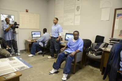 Left to right: Brian Acey, Greg Eskridge, Tommy Shakur Ross and Shadeed Wallace Stepter in the San Quentin Media Lab. Photo by Nigel Poor.