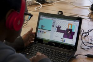 A participant creates an 8-bit sprite for his game in The Plug-In Studio Videogame Lab at Hyde Park Art Center. Photo by Kerry Richardson.