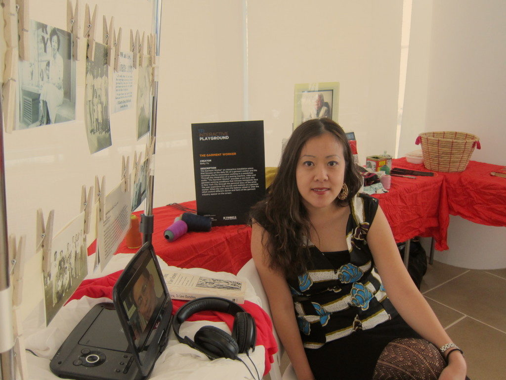 Betty Yu with The Garment Worker, an interactive media installation for community dialogue, at Tribeca Film Festival's Interactive Showcase, 2014. Courtesy the artist.