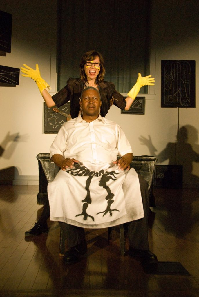 Production of Turning of the Bones by New Orleans writer Jan Villarubia. The performance used quirky musical numbers to explore the complexities of race in her family. Featuring Lisa Shattuck and Donald Lewis. Courtesy the artist.