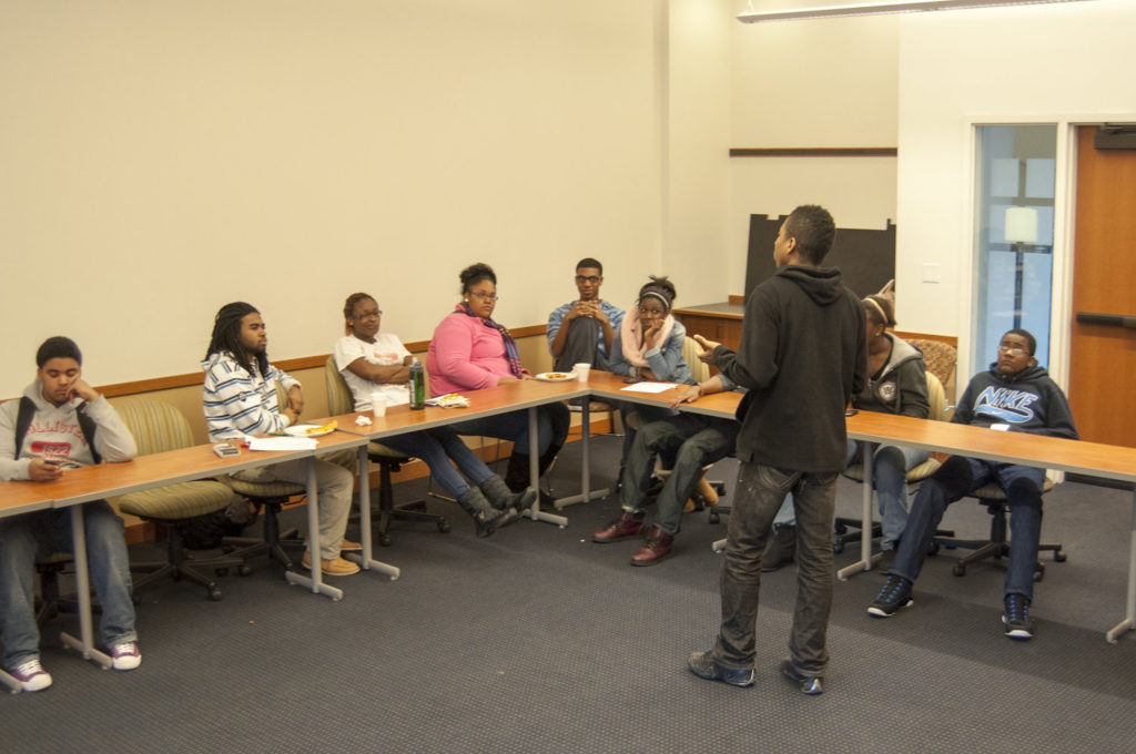In a youth mentoring summit, Freeman gives an overview to mentors and mentees on the importance of establishing rapport and genuine relationships. Courtesy of the artist.
