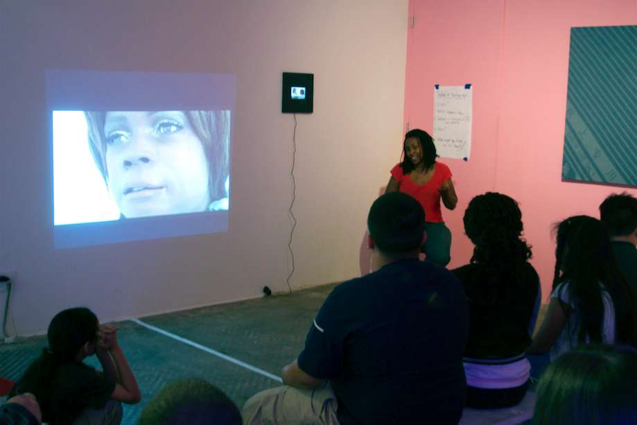 Speaking to students about Bina48, NURTUREart, 2015. Courtesy the artist.