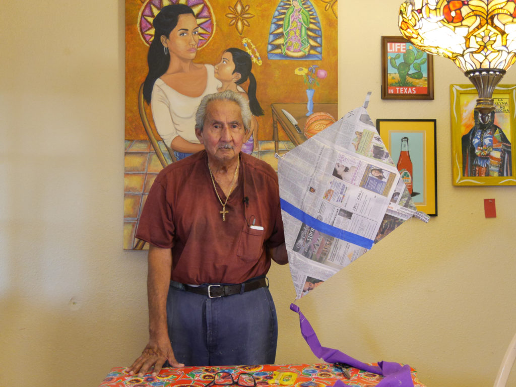 Kites Sin Fronteras, 2016, video still. Documentation of an intergenerational and cultural tradition of making kites from newspaper. IN this video a grandfather and granddaughter work to build a kite together. Project concept developed as part of Activating Vacancy Arts Incubator in collaboration with buildingcommunityWORKSHOP. Image courtesy of Christina Patiño Houle and Celeste De Luna.