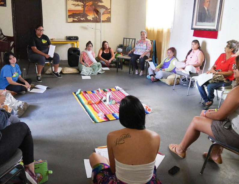 Círculo de Mujeres (Circle of Women), 2016. A half day workshop in which women came together to honor their bodies, lives, victories and struggles in a sacred circle. The event's activities included sage blessings, visioning, joyful dancing and group discussions. Project concept developed as part of Activating Vacancy Arts Incubator in collaboration with buildingcommunityWORKSHOP. Image: Christina Patiño Houle.