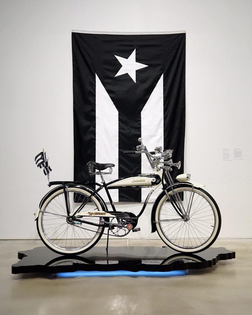 '51 (Se Acabaron las Promesas /The Promises Are Over)2012-20171951 Schwinn Hornet, custom platform, LEDs, flags. Courtesy the artist.