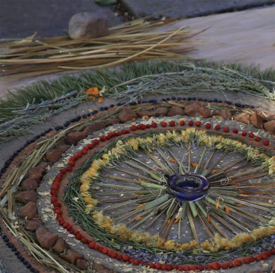 Earth mandala by cultural artist Venaya Yazzie as part of the culminating performance of SEEDS : REGENERATION, a project by ABOG Fellow Rulan Tangen and her Indigenous dance company Dancing Earth
