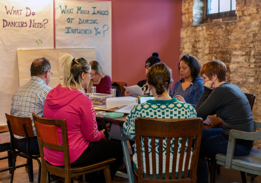 This first cohort of the Feminist Strip Club meets with University of Minnesota labor law specialist Stephen Befort to discuss employee vs. independent contractor status and worker misclassification. Photo by Boris Oicherman.