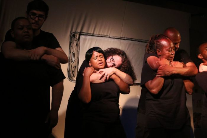 Every Time You See Me... (2013). The infamous, and fatal, chokehold that killed Eric Garner is transformed into an embrace as cast members actually see one another in their full humanity. Photo by Lauren Steussy.