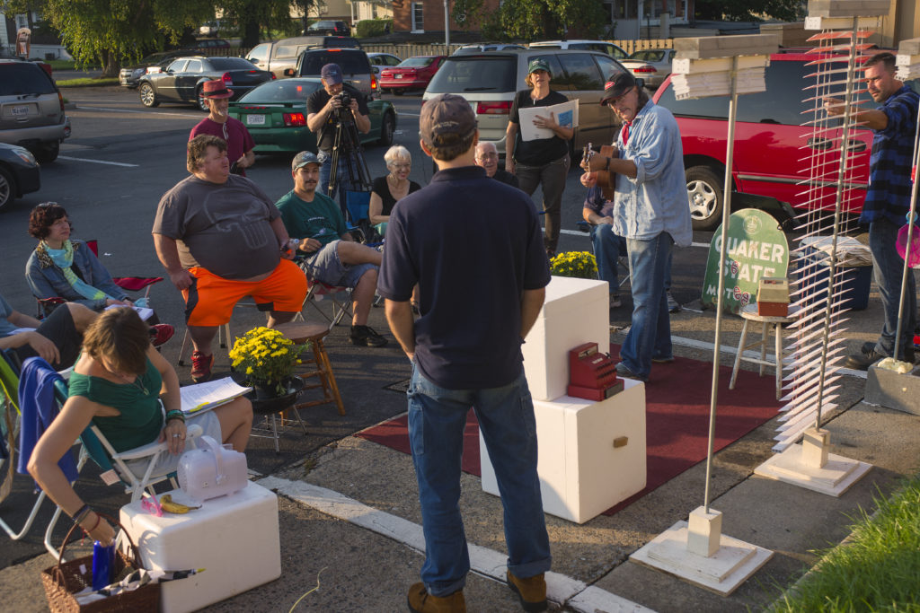 In a Hardee's parking lot, Dale Burleyson, narrator and musician in Good Old Boys, starts the performance with a song. The play was performed in front of intimate audiences and incorporated humor and The Dukes of Hazzard as a pop culture metaphor. Photo by Pat Jarrett.