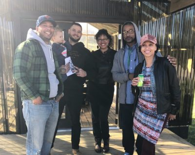 Jordan Weber (second from left), JoAnna LeFlore (far right), and community members at 4MX Greenhouse