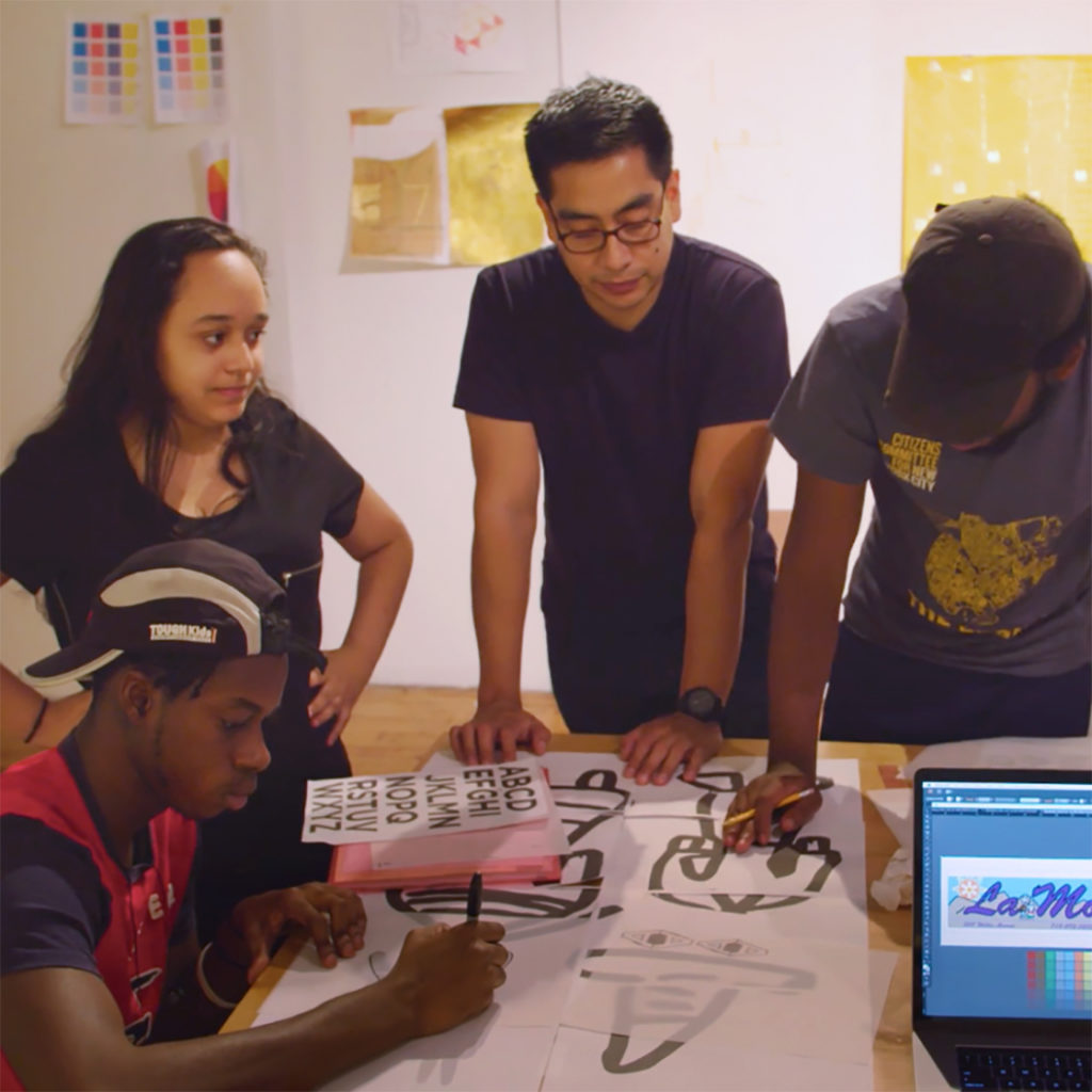 Ronny Quevedo and Higher Sails artists work on their designs for La Morada. Image courtesy RAVA Films.