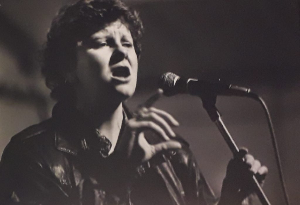 Theater director, actor, and poet Julie McNamara performs at a festival organized by Tyneside Disability Arts, one of many art events in the 1980s and 90s that celebrated disabled identity. Photograph by George Wallace, courtesy of Colin Cameron.