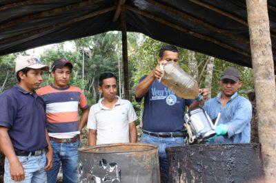 Petroecuador workers help clean underwater video casing, Orellana Province, Ecuador 2011. Photo: Laura Chipley
