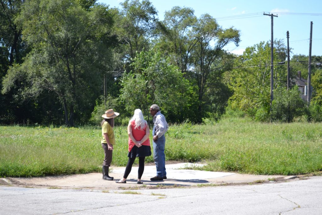 Frances Whitehead, Deb Backhus, and Walter Jones survey the site for Fruit Futures Initiative Gary. Courtesy the artist.