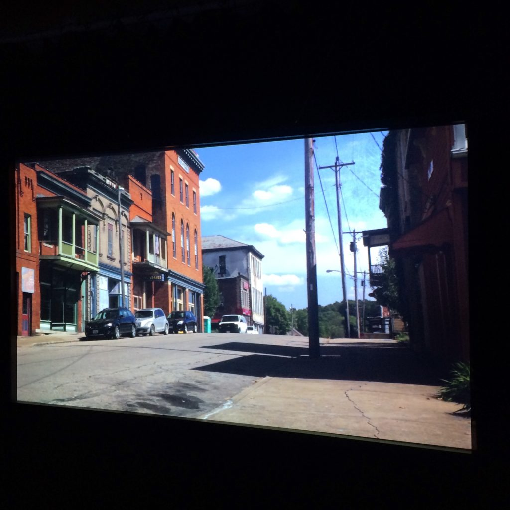 A gallery view of Shawnee Revisited, a sound and video installation exploring the past and present of energy extraction in Appalachian Ohio. At Carleton College, Northfield, Minnesota, 2018. Photo: Brian Harnetty.