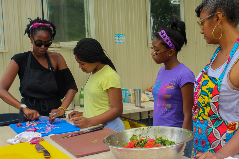 Reviewing knife skills, Our Mothers' Kitchens Camp, 2017. Photo: Gabrielle Clark.
