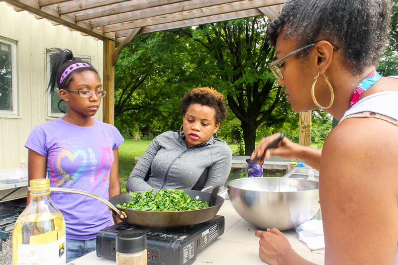 Seasoning and sautéing collards, Our Mothers' Kitchens Camp, 2017. Photo: Gabrielle Clark.