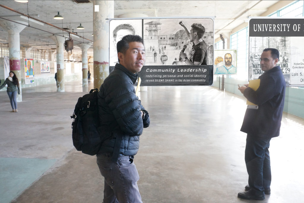 Kirn Kim and Dr. Luis Garcia stand in front of their Future IDs in a mockup design of the installation in the New Industries Building, Alcatraz. Courtesy Gregory Sale.