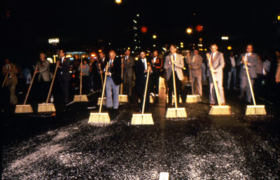 """Mierle Laderman Ukeles, """"Sanitation Celebrations: Grand Finale of the First NYC Art Parade, Part III: Ceremonial Sweep, 1983."""" Sanitation and union executives and municipal, arts, and cultural leaders clean the entire parade route along with the artist and her family. Courtesy of Ronald Feldman Fine Arts, photo: Paula Court."""