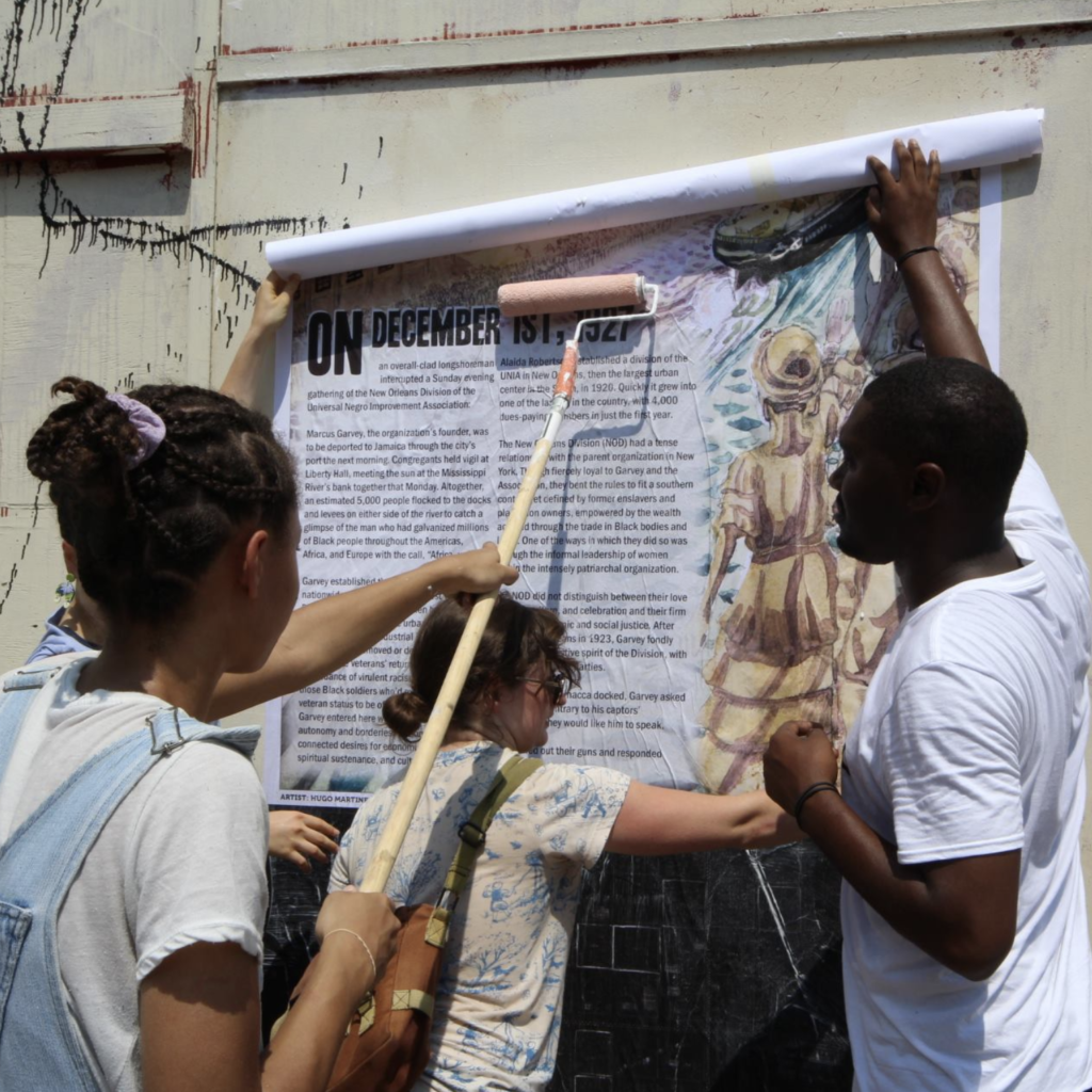 Installing posters as part of a public gallery of proposed monuments, via Paper Monuments