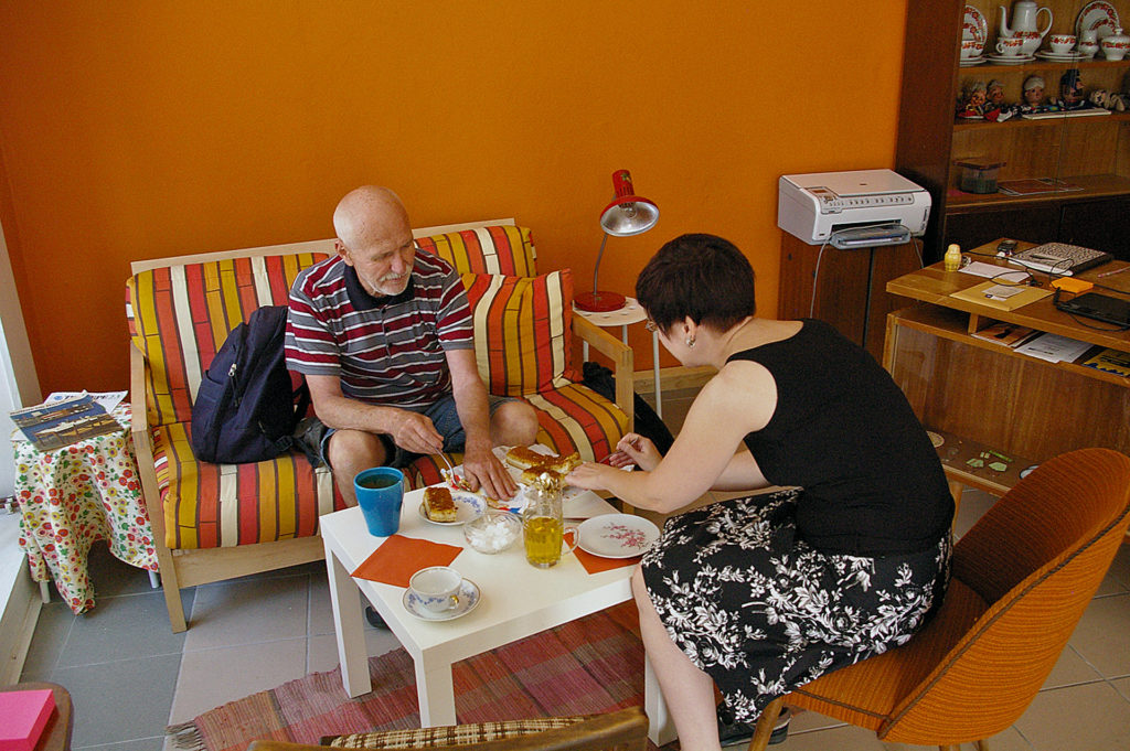 During open hours, visitors could record an interview, bring in objects for the archive or simply stop by to talk. Here, Monica and Pete share some Bienenstich and Apfelschorle. Photo by Matt Fritts.