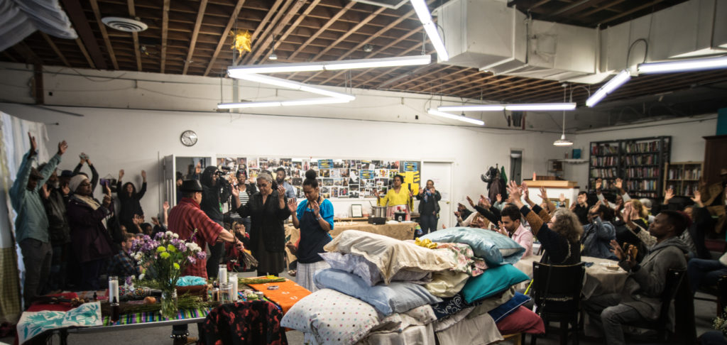 "House/Full of Blackwomen Episode: ""Black Womxn Dreaming,"" the blessing of the beds ceremony for a seven-day and night ritual of black women sleeping in a secret Oakland location. This ceremony invited the public to bring their pillows to be blessed, and to send the first wave of black women off to their ritual of rest, March 2017. Photo by Robbie Sweeny."