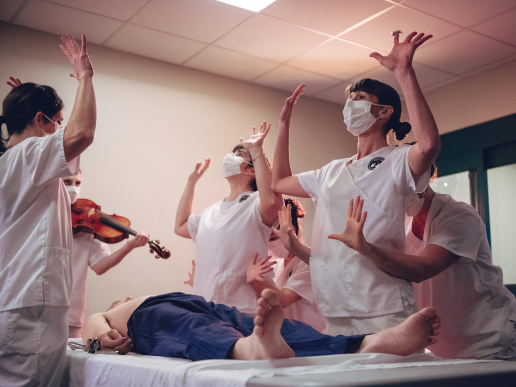 First, Do No Harm Opening Surgery Dance: Performers Cortney McGuire, Julie Rooney, Kate Speer, Tara Rynders, Rowan Salem, and Maegan Keller explore the nurses ability to grow additional arms in order to complete the many tasks needed in patient care. Photo by DW Burnett.