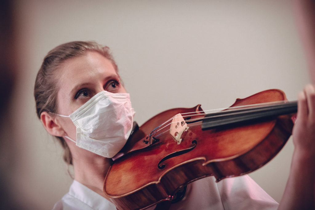 First, Do No Harm performer Julie Rooney conducting surgery through her viola. Photo by DW Burnett.