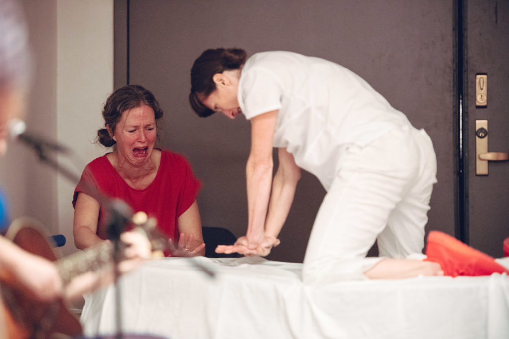 First, Do No Harm Nurse Tara Rynders initiating CPR on patient with patients wife performer Kristine Whittle. Photo by DW Burnett.