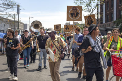 Walk the Talk parade in Skid Row, 2018. Photo by Monica Nouwens © Los Angeles Poverty Department.