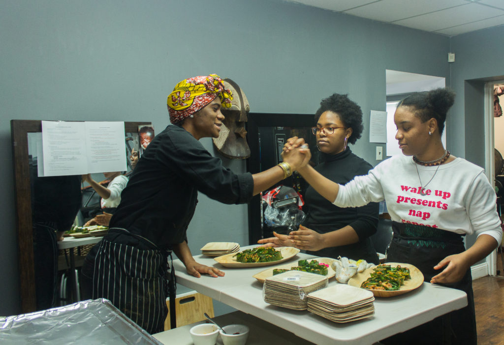 Chef Laquanda Dobson and volunteers Amaia and Nailah at the Zora Neale Hurston Dinner. Photo by Gabrielle Clark.