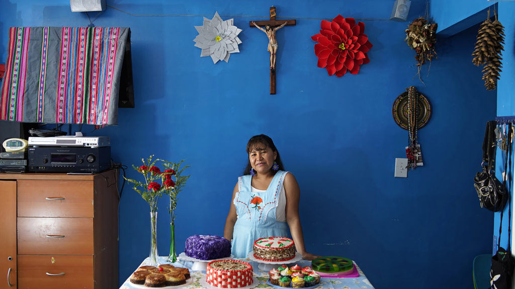 Roberta, a member of Mujeres en Movimiento, poses for a portrait during a photography workshop organized by Sol Aramendi after having realized her dream of becoming a pastry chef. Image courtesy of Sol Aramendi.