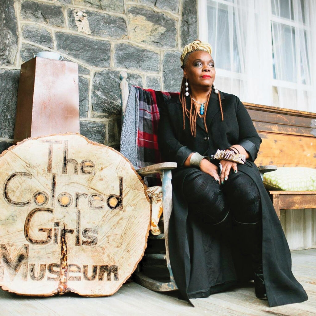 Executive Director and founder Vashti DuBois sits in front of The Colored Girls Museum.