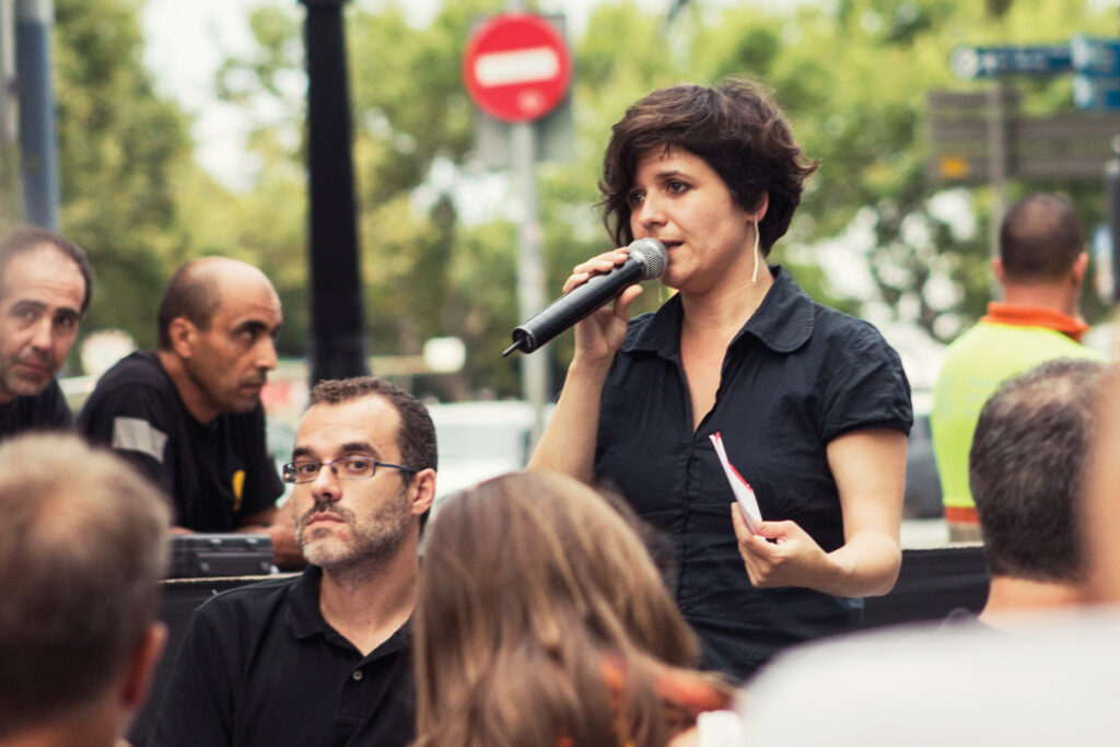 Gala Pin, the former councilor of citizen participation in the Barcelona City Council, leads an open meeting with residents in her district Ciutat Vella.