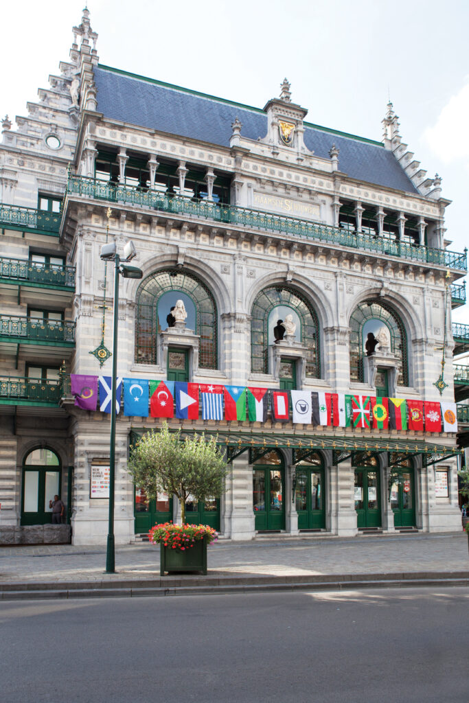 Flags of unrecognized people and states hang on the front of the KVS Royal Flemish theater in Brussels where the New World Summit – Brussels took place in 2014.